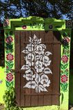 Painted old wooden cottage decorated with a hand painted colorful flowers, Zalipie, Poland. ZALIPIE, POLAND - AUGUST 3, 2018: Painted old wooden cottage stock photography