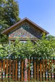 Painted old wooden fence decorated with a hand painted flowers, Zalipie, Poland. ZALIPIE, POLAND - AUGUST 3, 2018: Painted old wooden fence decorated with a hand stock image
