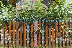 Painted old wooden fence decorated with a hand painted colorful flowers, Zalipie, Poland. ZALIPIE, POLAND - AUGUST 3, 2018: Painted old wooden fence decorated royalty free stock photo