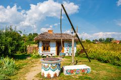 Traditional farmstead with a well in the colorful village of Zalipie, Poland. It is known for a. Zalipie, Poland, August 19, 2018: traditional farmstead with a royalty free stock photography