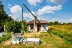Traditional farmstead with a well in the colorful village of Zalipie, Poland. It is known for a. Zalipie, Poland, August 19, 2018: traditional farmstead with a stock photo