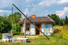 Traditional farmstead with a well in the colorful village of Zalipie, Poland. It is known for a. Zalipie, Poland, August 19, 2018: traditional farmstead with a stock photos