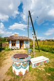 Traditional farmstead with a well in the colorful village of Zalipie, Poland. It is known for a. Zalipie, Poland, August 19, 2018: traditional farmstead with a stock photography