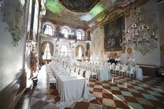 Zalzburg, Austria - December 19, 2015:  HOTEL SCHLOSS LEOPOLDSKRON. Zalzburg, Austria - December 19, 2015: Wedding reception with floral arrangement of white Royalty Free Stock Photography