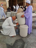 Zam water. Saudi Arabia. 23 March 2011 : People drink zam water after praying at Nabawi Mosque compound Stock Image