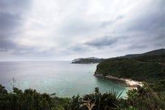 Zamami海岛在多云天空下 库存图片