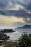 Zamami海岛在多云天空下 库存照片