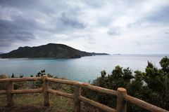 Zamami island under cloudy sky. Aka island and Zamami island are located some 15 miles to the southwest of Okinawa Island. You can get a good view of zamami Royalty Free Stock Photos