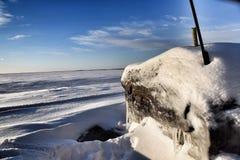 Zamarznięty kamień na plaży Zdjęcia Royalty Free