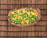 Zamarznięci organicznie grochy i kukurudza Zdjęcia Royalty Free