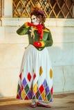 Zamaskowana kobieta z kukłą zdjęcie royalty free