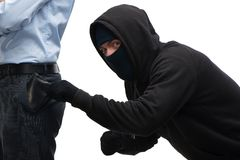 Zamaskowany kradzieżowy próbować kraść portfel zdjęcia royalty free