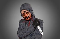 Zamaskowany mężczyzna z nożem Fotografia Royalty Free