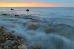Zamazana morze fala przy świtem Fotografia Royalty Free