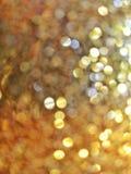 Zamazanej lekkiej złotej błyskotliwości błyszczący dekoracyjny tło obraz royalty free