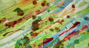 Zamazanej zielonej czerwieni błotnisty woskowaty żywy tło w żywych odcieniach Fotografia Royalty Free