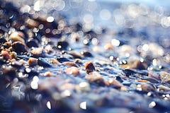Zamazani świecenia morza kamienie Fotografia Stock