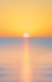 Zamazany lata morze przy świtem Fotografia Stock