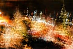 Zamazany ruch światła przy nocą zdjęcie stock