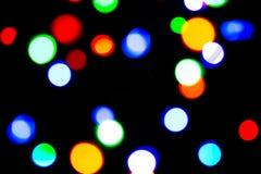 Zamazany tło z kolorowym bokeh zaświeca na ciemnych purpurach i błękita tło/zamazywał bożonarodzeniowe światła Zdjęcie Royalty Free