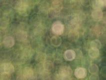 Zamazany tło z zielonymi i żółtymi bokeh okręgami Obrazy Royalty Free