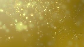 Zamazany złoty pył wolno spada przeciw żółtemu tłu zbiory