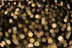 Zamazuje ostrość światło na czarnym tle od lampy w nocy na bożych narodzeniach przed nowego roku 2018 w ten sposób pięknym romant Zdjęcie Stock