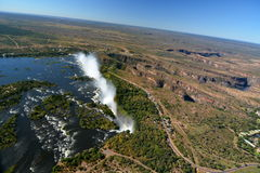 Zambesi river and Victoria Falls. Zimbabwe. Victoria Falls, or Mosi-oa-Tunya (the Smoke that Thunders), is a waterfall in southern Africa on the Zambezi River at Royalty Free Stock Photos