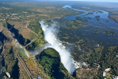 Zambesi river and Victoria Falls. Zimbabwe. Victoria Falls, or Mosi-oa-Tunya (the Smoke that Thunders), is a waterfall in southern Africa on the Zambezi River at Royalty Free Stock Photography