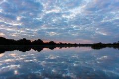 Zambezi rzeka przy zmierzchem Fotografia Stock