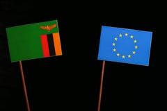 Zambia flag with European Union EU flag  on black Royalty Free Stock Images