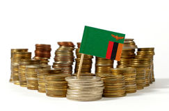 Zambia flag with stack of money coins Royalty Free Stock Images
