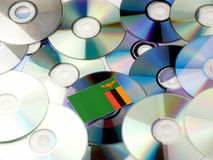 Zambia flag on top of CD and DVD pile isolated on white Stock Images