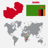 Zambia map on a world map with flag and map pointer. Vector illustration Stock Image