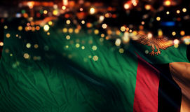 Zambia National Flag Light Night Bokeh Abstract Background Stock Photo