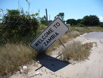 Zambia road sign. Welcome to Zambia damaged sign Stock Images