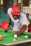 Zambian black guys play billiards stock photos