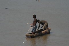 Zambian fishermen in a boat Royalty Free Stock Images