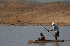 Zambian fishermen doing dangerous work Royalty Free Stock Photography