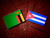 Zambian flag with Cuban flag on a tree stump isolated Royalty Free Stock Photography