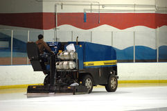 Resurfacing machine. A resurfacing machine prepares the ice in a skating rink royalty free stock photography