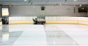 Zamboni flooding ice rink Stock Image