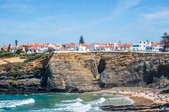 Free Zambujeira Do Mar PORTUGAL - 13 August 2019 - View Of Typical Village Houses With Cliff By The Sea, Beach Day With Several Familie Stock Photo - 184993320