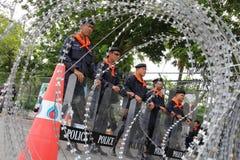 Zamieszki polici drut kolczasty Fotografia Royalty Free