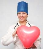 zamknięta lekarka wręcza serce zamknięty Obraz Royalty Free