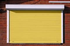 Zamknięte żółte ochron żaluzje Fotografia Stock