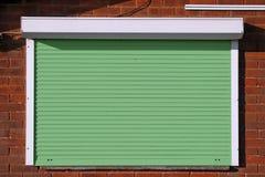 Zamknięte zielone ochron żaluzje Obrazy Stock