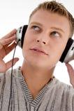 zamknięty słuchawki zamknięty mężczyzna obrazy stock
