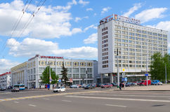 Zamkovaya street. Tourist and hotel complex Vitebsk Hotel, department store, Belarus. VITEBSK, BELARUS - MAY 22, 2017: Unknown people are walking along Zamkovaya Royalty Free Stock Image