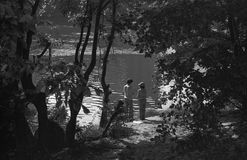 ZAMORA, SPAIN –JULY, 1979. Two boys fish in the river Duero, between the trees on the shore on July, 1979 in Zamora, Spain.  Black and white Stock Images